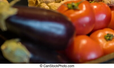 Fresh ripe vegetables. Selective focus on tempting tomatoes and aubergine lying together