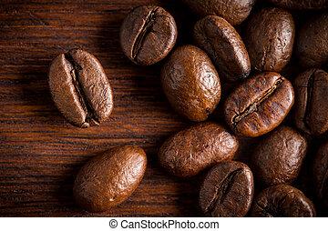 fresh roasted coffee beans macro close oak wood background