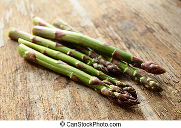 Fresh roots of asparagus vegetable on the wooden table