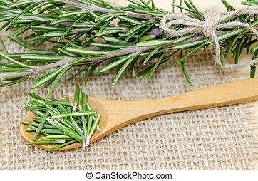 fresh rosemary in a wooden spoon
