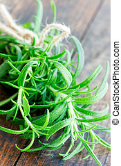 Fresh rosemary on a wooden board close up