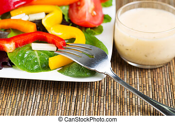 Fresh Salad and Dressing with Fork