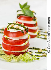 fresh salad caprese in vertical on plate