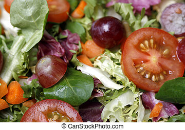 Delicious fresh and healthy salad with lettuce and tomatoes
