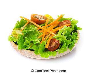 Fresh salad in a wooden plate