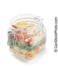 fresh salad in glass jar on white background