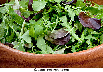 fresh salad mix in wooden bowl closeup