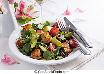Fresh salad plate with shrimp, tomato and mixed greens