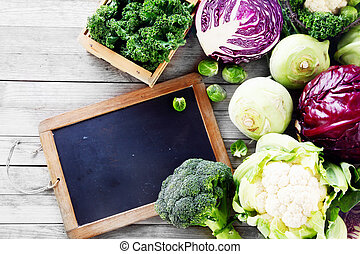 Fresh Salad Vegetables on Table with Chalkboard - Close up ...