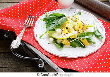 fresh salad with apple, celery and orange