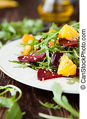 fresh salad with arugula and citrus, healthy food