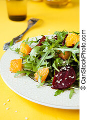 fresh salad with arugula and orange