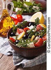 fresh salad with arugula, feta cheese and tomatoes, vertical