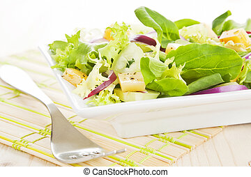 Fresh salad with cheese.