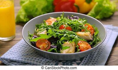 Fresh salad with chicken, tomatoes, arugula, mesclun, basil...