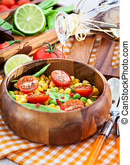 Fresh salad with corn, peas, tomato and chilli