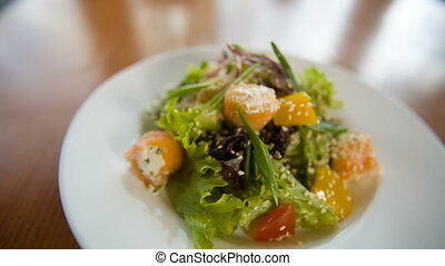 Fresh salad with fish - Fresh green salad with fish