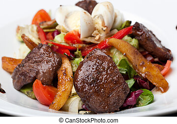 Fresh salad with meat and quail eggs