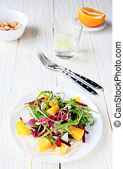fresh salad with orange slices