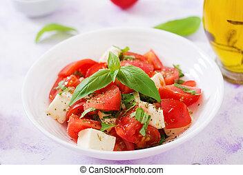 Fresh salad with tomato, mozzarella and basil