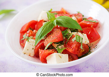 Fresh salad with tomato, mozzarella and basil