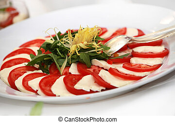 tomatoes and mozarella - fresh salad with tomatoes and...