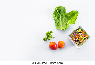 Fresh salad with tomatoes, spinach in a plate on white background, top view