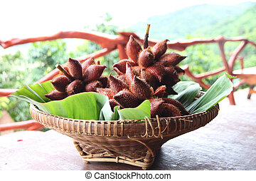 Fresh Salak snake fruit in basket. - Fresh Salak snake fruit...