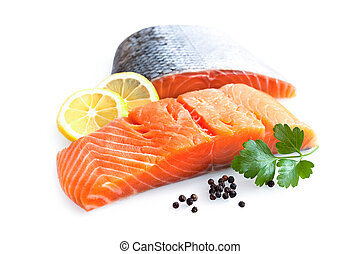 fresh salmon fillet with parsley and lemon slices isolated...