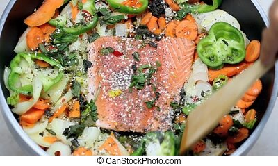 salmon fillet - fresh salmon fillet with vegetables in the...