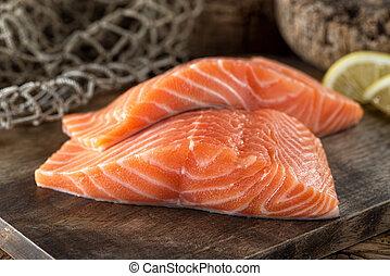 Fresh Salmon Fillets - Fresh raw salmon fillets on a wooden...