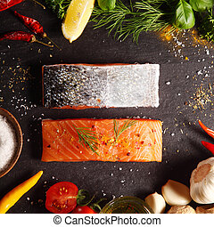 Fresh salmon fillets in a frame of ingredients