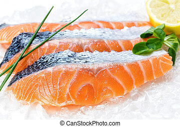 Fresh salmon fillets on ice. - Macro close up of fresh ...