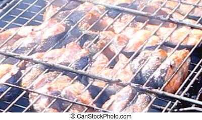 Fresh salmon fish on grilling stick