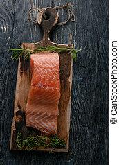 fresh salmon on a wooden board