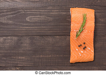 Fresh salmon on wooden background with a lot of copy space for your text or editing