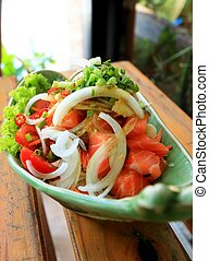 Fresh salmon salad with spices