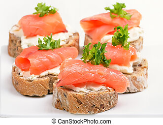 Fresh salmon snack with curd, close up view