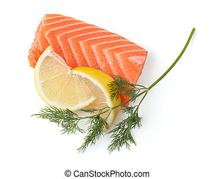 Fresh salmon steak with lemon slices and dill. Isolated on...