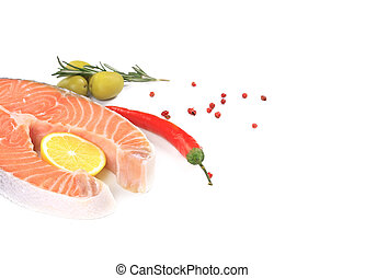 Fresh salmon steak with vegetables. Whole background.