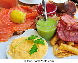 Fresh Salmon with lemon and bread - A seafood salad with smoked salmon Bacon and Fries with seafood salad