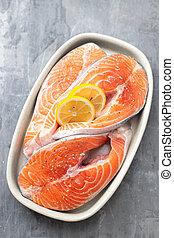 fresh salmon with lemon on dish