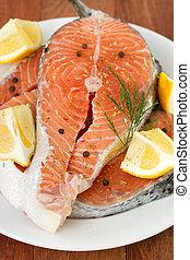 fresh salmon with lemon on plate