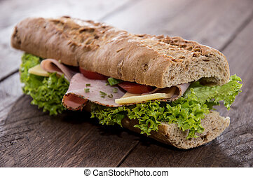 Fresh Sandwich with Ham and Cheese decorated with fresh...