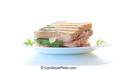 fresh sandwich with vegetables, bacon and cheese on a white...