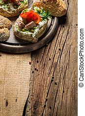 Fresh sandwiches on a old wooden cutting board background 1