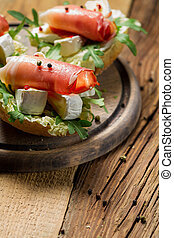 Fresh sandwiches on a old wooden cutting board background 2