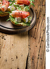 Fresh sandwiches on a old wooden cutting board background 5