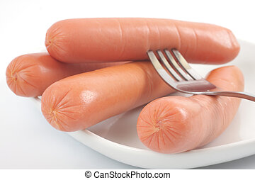 Fresh sausages on a plate
