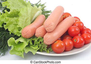 Fresh sausages on a plate with vegetables.